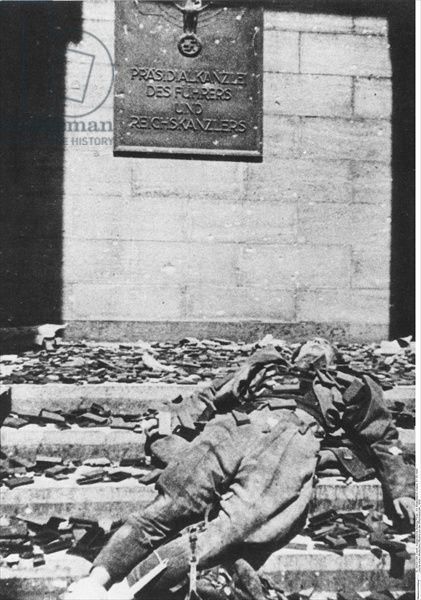May-1945-The-dead-body-of-a-German-officer-lying-on-the-steps-of-the-Reich-Chancellery-following-the-Battle-of-Berlin.